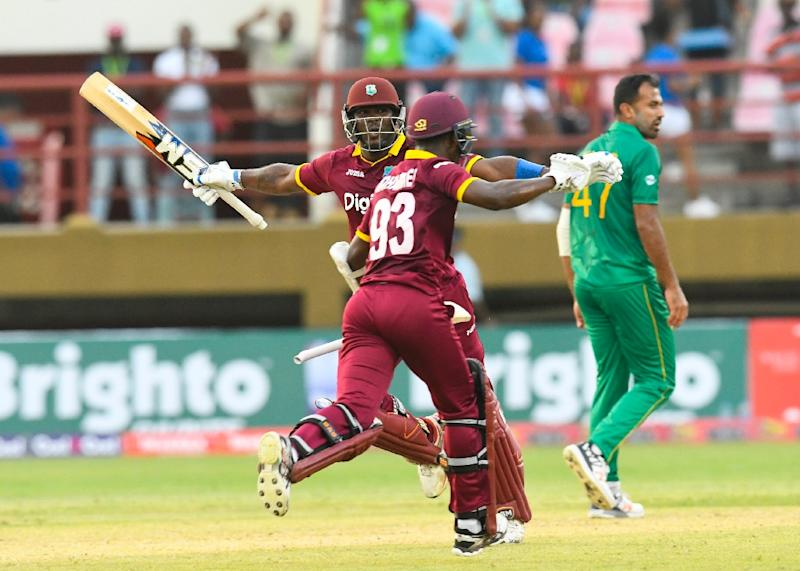 Wahab Riaz (R) of Pakistan walks off the field as Ashley Nurse (L) and Jason Mohammed (C) of West Indies celebrate winning the 1st ODI match at Guyana National Stadium, Providence, Guyana, on April 7, 2017 (AFP Photo/Randy BROOKS)