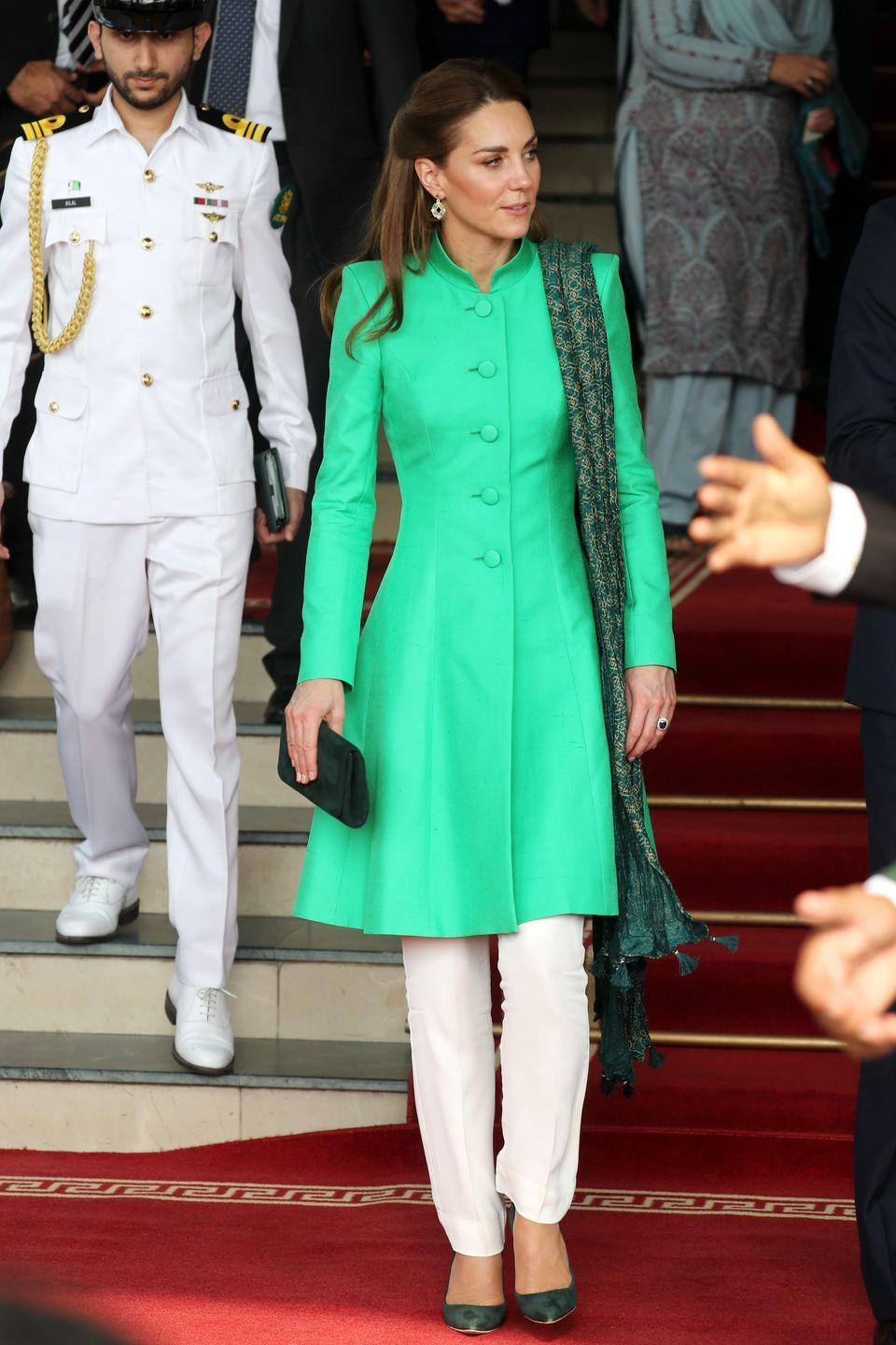 <p>The Duchess of Cambridge at the residence of Pakistan's Prime Minister, Imran Khan. She wore a coat dress by Catherine Walker. </p>