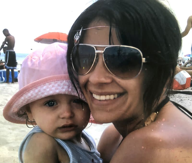 Brittany Schlarb smiles with her youngest daughter in Daytona Beach