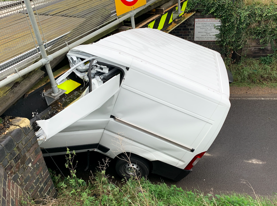 The van split right down the middle after becoming lodged underneath the structure (SWNS)