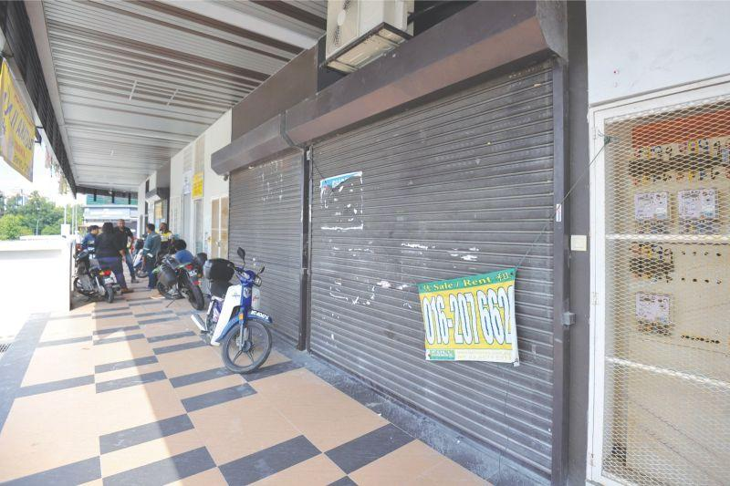 The shop in Jalan BK 5A/2D, Kinrara Niaga, was shuttered when Malay Mail visited the area yesterday. The outlet in Sepang has been closed since the rape incident. — Picture by Mukhriz Hazim