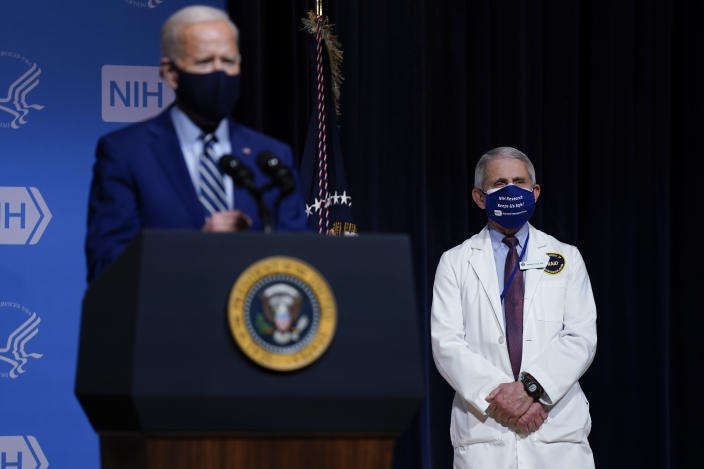 President Joe Biden speaks during a visit to the Viral Pathogenesis Laboratory at the National Institutes of Health, Thursday, Feb. 11, 2021, in Bethesda, Md. Dr. Anthony Fauci, director of the National Institute of Allergy and Infectious Diseases, listens at right. (AP Photo/Evan Vucci)