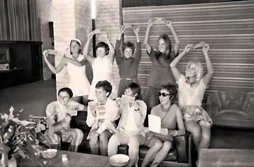 "The ""Original 9"" women's tennis players pose with dollar bills Sept. 23, 1970, at the Houston Racquet Club."