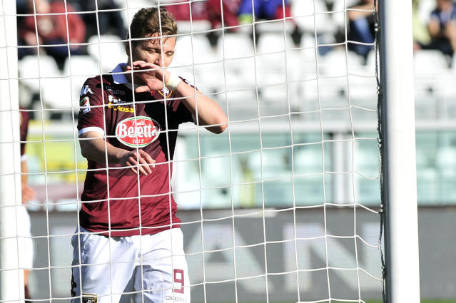 Torino forward Ciro Immobile touches his face after he failed a scoring chance during a Serie A soccer match between Torino and Sampdoria at the Olympic stadium, in Turin, Italy, Sunday, March 2, 2014. (AP Photo/ Massimo Pinca)