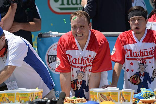 <p>Current world record holder Joey Chestnut (L) after beating top contender Matt Stonie for the win at Nathan's Famous Fourth of July International Hot Dog Eating Contest at Coney Island in Brooklyn, New York City, U.S., July 4, 2017. (Erik Pendzich/REX/Shutterstock) </p>