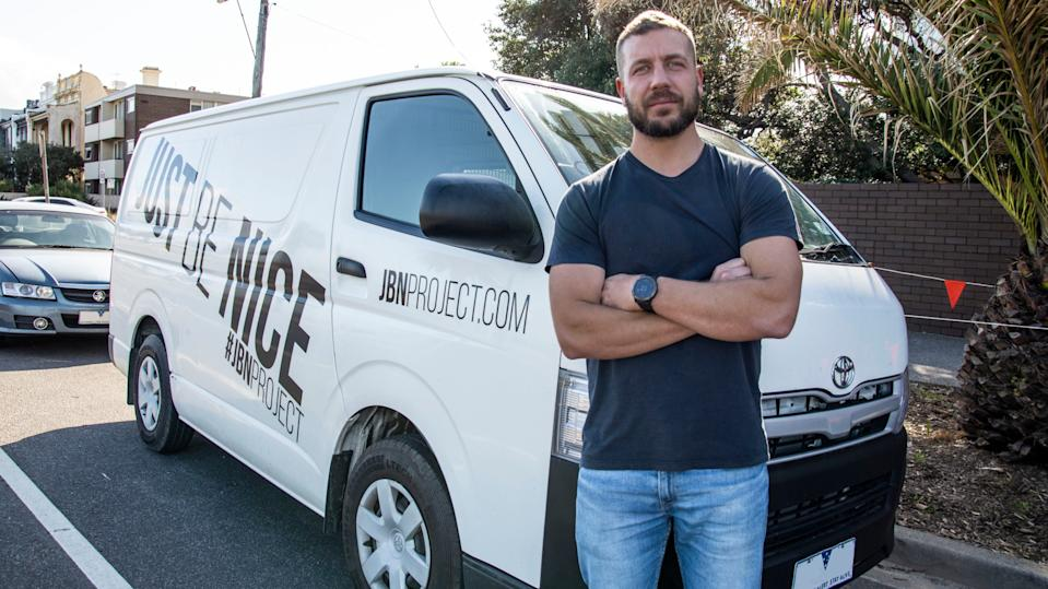 Melbourne man Josh Reid Jones stands in front of his van, which he rents out on Car Next Door.