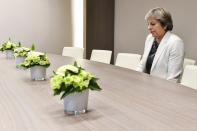 FILE - In this Friday, Oct. 20, 2017 file photo British Prime Minister Theresa May waits for the arrival of European Council President Donald Tusk prior to a bilateral meeting with European Council President Donald Tusk during an EU summit in Brussels. Britain and the European Union have struck a provisional free-trade agreement that should avert New Year's chaos for cross-border commerce and bring a measure of certainty to businesses after years of Brexit turmoil. The breakthrough on Thursday, Dec. 24, 2020 came after months of tense and often testy negotiations that whittled differences down to three key issues: fair-competition rules, mechanisms for resolving future disputes and fishing rights. (AP Photo/Geert Vanden Wijngaert, Pool)