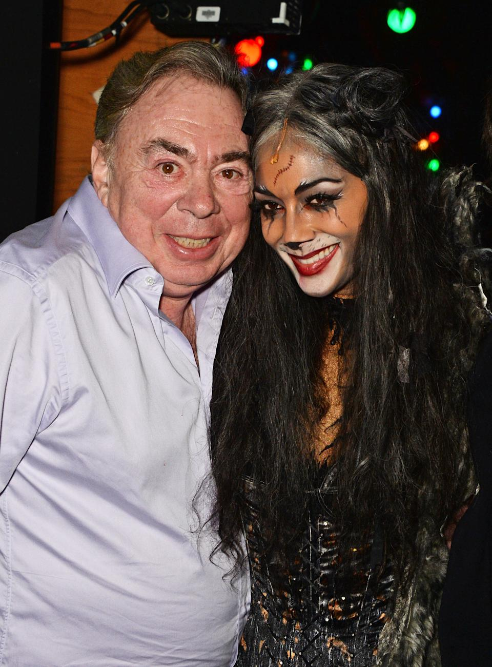 """LONDON, ENGLAND - DECEMBER 11:  Lord Andrew Lloyd Webber (L) and Nicole Scherzinger pose backstage following the press night performance of """"Cats"""" as Nicole Scherzinger joins the cast at the London Palladium on December 11, 2014 in London, England.  (Photo by David M. Benett/Getty Images)"""