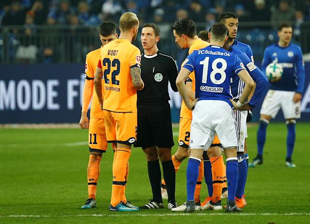 Soccer Football - Bundesliga - Schalke 04 vs TSG 1899 Hoffenheim - Veltins-Arena, Gelsenkirchen, Germany - February 17, 2018 Referee Benjamin Brand talks to Hoffenheim's Kevin Vogt REUTERS/Leon Kuegeler DFL RULES TO LIMIT THE ONLINE USAGE DURING MATCH TIME TO 15 PICTURES PER GAME. IMAGE SEQUENCES TO SIMULATE VIDEO IS NOT ALLOWED AT ANY TIME. FOR FURTHER QUERIES PLEASE CONTACT DFL DIRECTLY AT + 49 69 650050