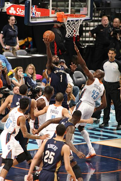 CHARLOTTE, NC - FEBRUARY 21: Tyreke Evans #1 of the New Orleans Pelicans shoots against the Charlotte Bobcats during the game at the Time Warner Cable Arena on February 21, 2014 in Charlotte, North Carolina. (Photo by Kent Smith/NBAE via Getty Images)