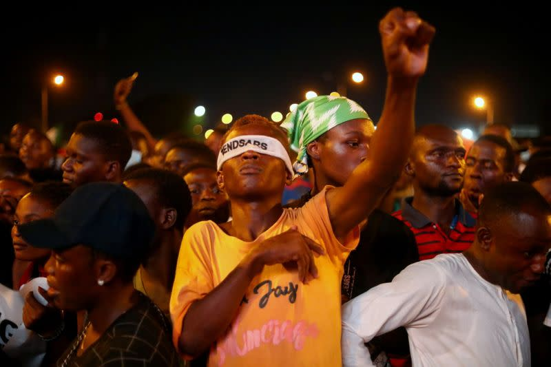 """A demonstrator wearing a blindfold with an inscription """"End Sars"""", gestures during protest against alleged police brutality in Lagos"""
