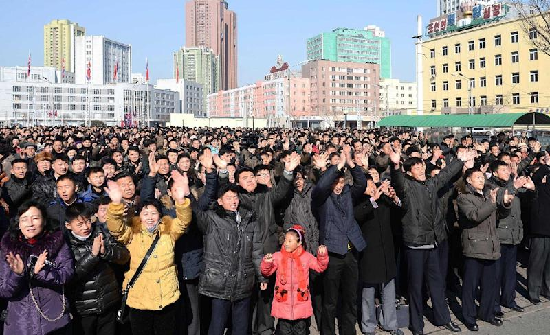 North Korean people celebrate a report on the country's rocket launch in Pyongyang (AFP Photo/)