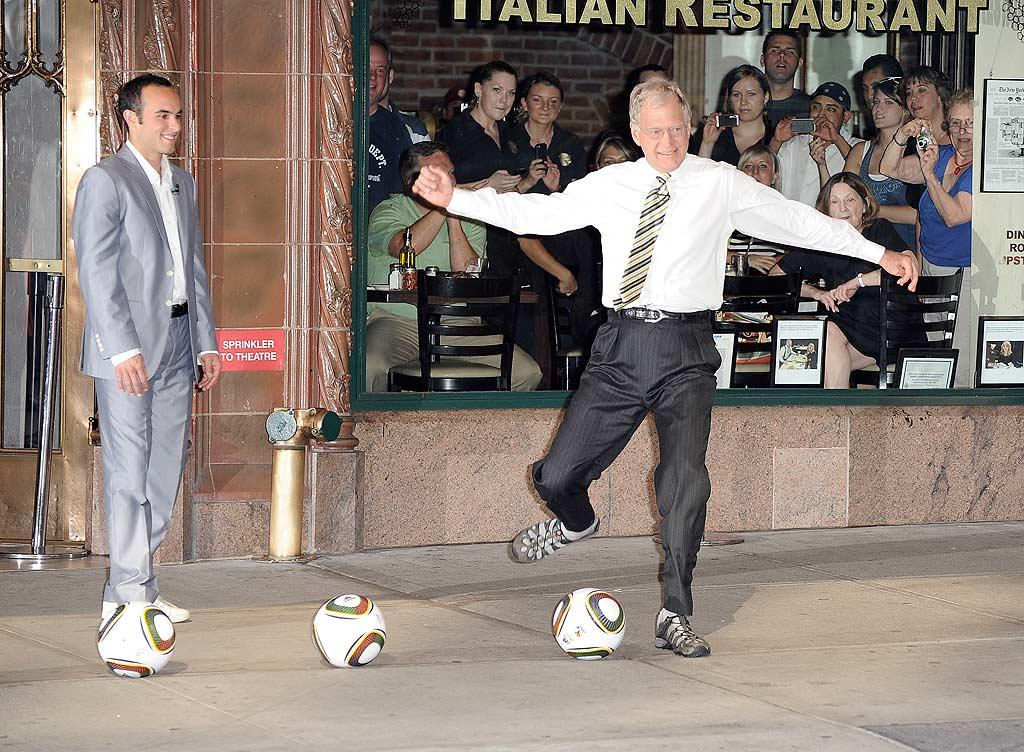 "The guys attempted to kick a soccer ball into the open door of a cab driving by on the street. Dave, 63, gave the ""Late Show Soccer Challenge"" a good go ... but he failed. <a href=""http://www.splashnewsonline.com"" target=""new"">Splash News</a> - June 29, 2010"