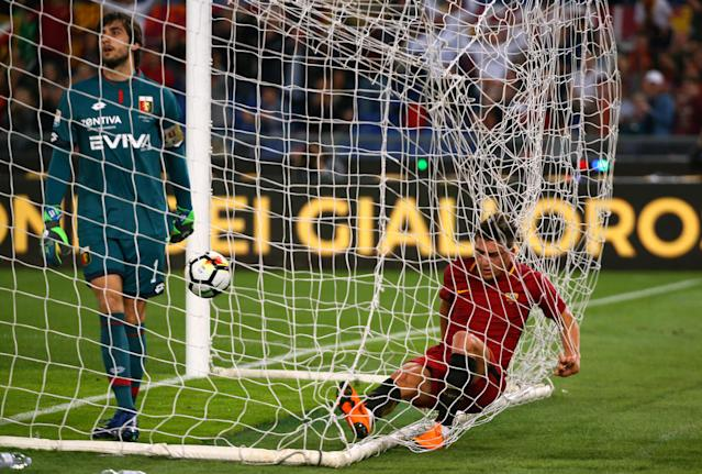 Soccer Football - Serie A - AS Roma vs Genoa - Stadio Olimpico, Rome, Italy - April 18, 2018 Roma's Cengiz Under in the net as he celebrates scoring their first goal REUTERS/Alessandro Bianchi