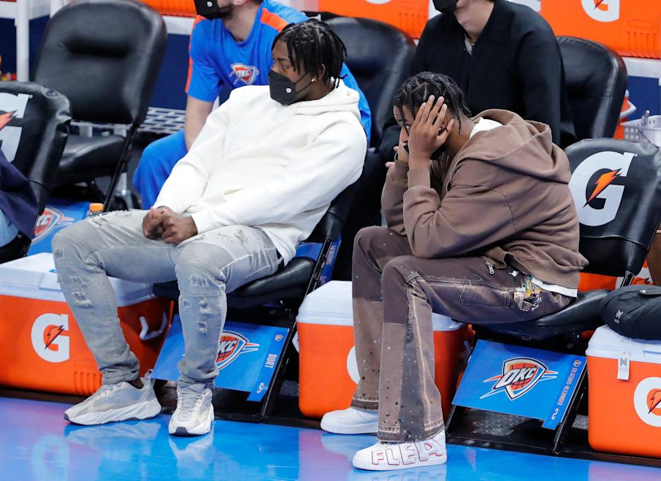 Oklahoma City Thunder forward Luguentz Dort (left) and guard Shai Gilgeous-Alexander (right) watch as their team takes on the Indiana Pacers.