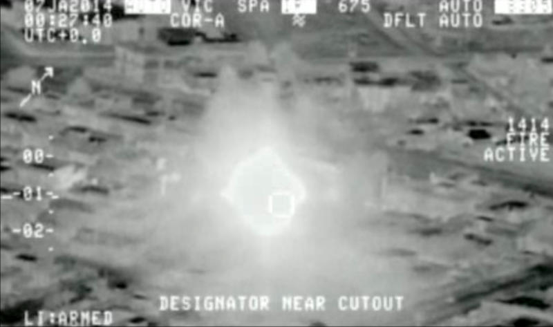 This Jan. 7, 2014 photo from aerial video provided by the Iraq Defence Ministry, but which the authenticity of cannot be independently verified by The Associated Press, shows an ammunition dump on fire after being hit by an airstrike, in Anbar Province, Iraq. (AP Photo/Iraq Defence Ministry)