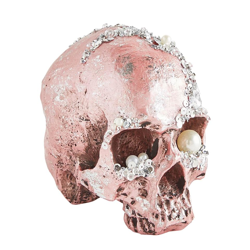 """<p>This <a href=""""https://www.popsugar.com/buy/Bejeweled-Pink-Halloween-Skull-479529?p_name=Bejeweled%20Pink%20Halloween%20Skull&retailer=pier1.com&pid=479529&price=18&evar1=casa%3Aus&evar9=46495717&evar98=https%3A%2F%2Fwww.popsugar.com%2Fphoto-gallery%2F46495717%2Fimage%2F46495719%2FBejeweled-Pink-Halloween-Skull&list1=halloween%2Cpier%201%2Challoween%20decor&prop13=api&pdata=1"""" rel=""""nofollow"""" data-shoppable-link=""""1"""" target=""""_blank"""" class=""""ga-track"""" data-ga-category=""""Related"""" data-ga-label=""""http://www.pier1.com/bejeweled-pink-halloween-skull/4117740.html"""" data-ga-action=""""In-Line Links"""">Bejeweled Pink Halloween Skull</a> ($18) will look chic as a centerpiece on your table, no extra highlight or blush needed.</p>"""