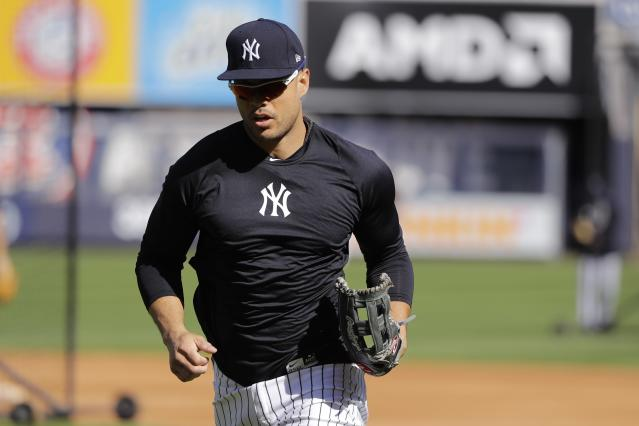New York Yankees' Giancarlo Stanton runs on the field during a team practice at Yankee Stadium Thursday, Oct. 10, 2019, New York. The Yankees will play the winner of tonight's Tampa Bay Rays at Houston Astros American League Division Series game in Game 1 of the American League Championship Series on Saturday, Oct. 12 in New York. (AP Photo/Frank Franklin II)