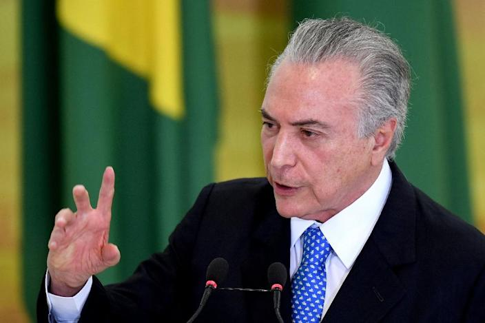 Brazilian acting President Michel Temer has vowed to cut spending and push through controversial labor and pension reforms (AFP Photo/Evaristo Sa )