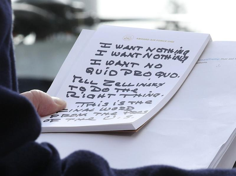 Trump's handwritten notes maintaining his innocence last week, during an address to reporters about the impeachment investigation | Mark Wilson/Getty
