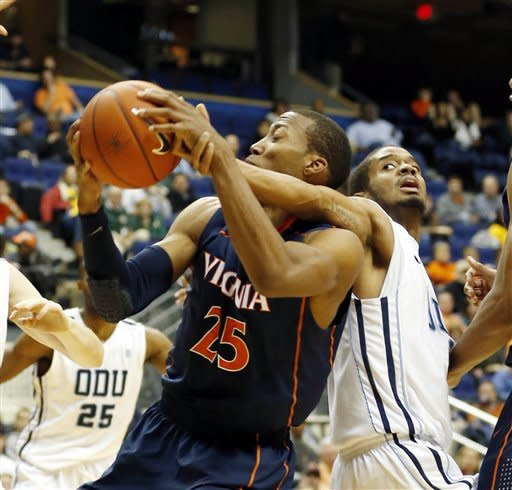 Old Dominion's Aaron Bacote, right, reaches around his back to get his hand on a shot by Virginia's Akil Mitchell, left, during first half action of an NCAA college basketball game in the 2012 Governor's Holiday Hoops Classic at The Richmond Coliseum in Richmond, VA.,Saturday,Dec., 22,2012. (AP Photo/The Richmond Times-Dispatch, Joe Mahoney)