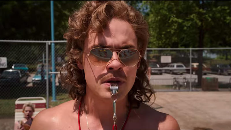 Dacre Montgomery plays Billy Hargrove pool side in Stranger Things 3