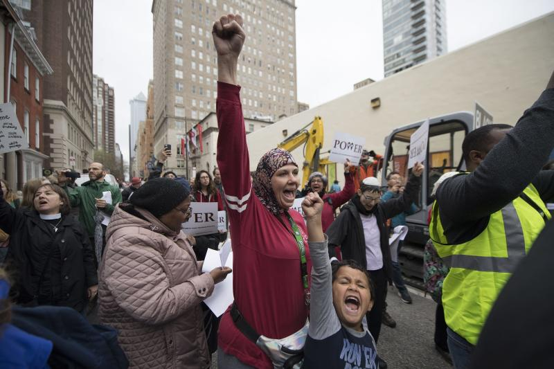 Jennifer Bennetch with her son Yusuf Williams-Bey protest outside the Starbucks on 18th & Spruce Streets in Philadelphia, Monday, April 16, 2018. Two African-American men were arrested a week earlier in a video incident that went viral. (Jose F. Moreno/The Philadelphia Inquirer via AP)