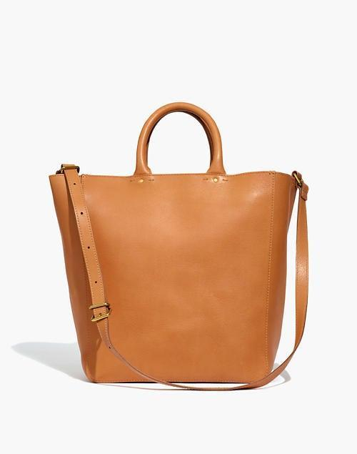 """<br><br><strong>Madewell</strong> The Abroad Tote, $, available at <a href=""""https://go.skimresources.com/?id=30283X879131&url=https%3A%2F%2Fwww.madewell.com%2Fthe-abroad-tote-AH913.html%3Fdwvar_AH913_color%3DNA7207%26cgid%3Dsale-auto"""" rel=""""nofollow noopener"""" target=""""_blank"""" data-ylk=""""slk:Madewell"""" class=""""link rapid-noclick-resp"""">Madewell</a>"""