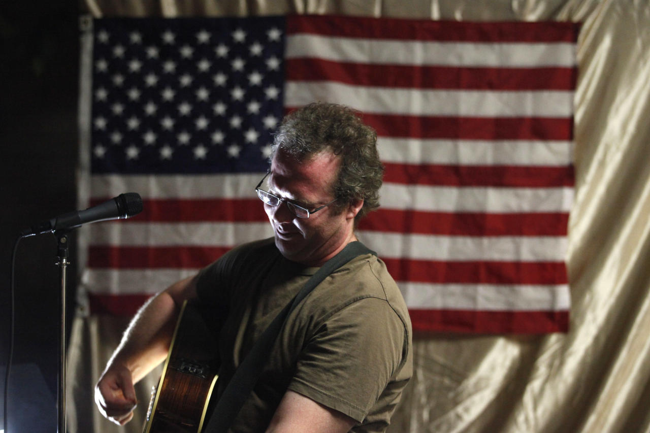 In this Thursday, June 7, 2012 photo, Jason Moon, a veteran and singer-songwriter, performs during his concert in Glendale, Calif. Moon, who served in the Army in the Iraq War, suffers from post-traumatic stress disorder, and has written an album of songs about his experience that he shares with veterans and civilians. (AP Photo/Jae C. Hong)