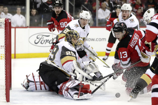 New Jersey Devils center Nico Hischier (13), of Switzerland, attacks as Vegas Golden Knights goaltender Marc-Andre Fleury (29) defends his net during the second period of an NHL hockey game, Friday, Dec. 14, 2018, in Newark. (AP Photo/Julio Cortez)