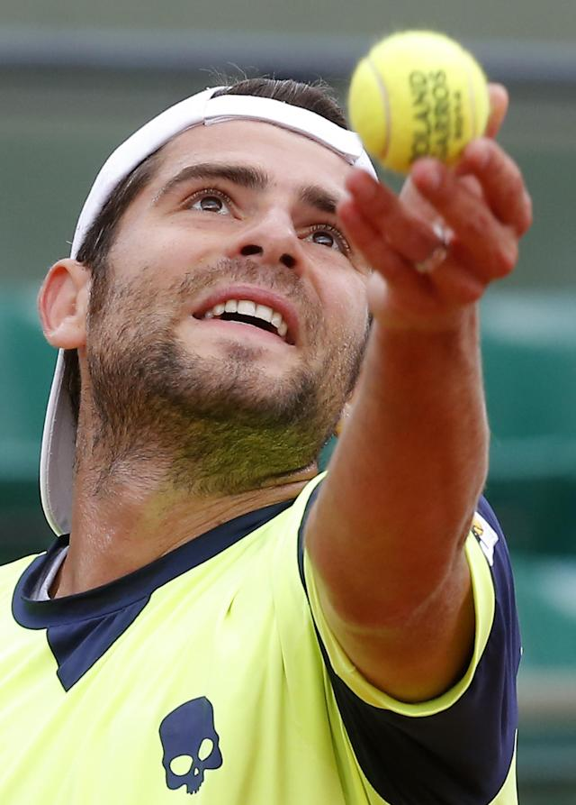 Italy's Simone Bolelli serves the ball to Spain's David Ferrer during their second round match of the French Open tennis tournament at the Roland Garros stadium, in Paris, France, Thursday, May 29, 2014. (AP Photo/Michel Euler)