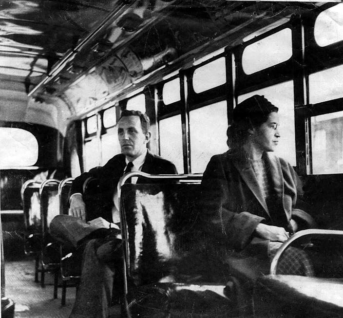 An undated file photo of Rosa Parks riding on a Montgomery Area Transit System bus. Parks refused to give up her seat on a Montgomery bus on Dec. 1, 1955, and ignited the boycott that led to a federal court ruling against segregation in public transportation.