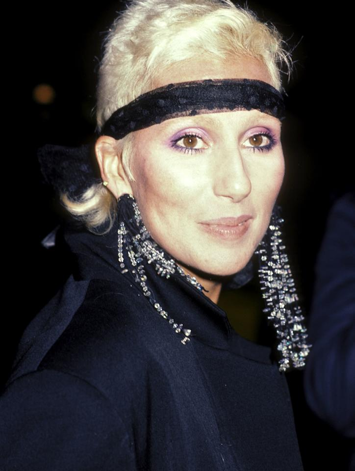 Pairing her lavender smoky eye with her platinum blonde locks and a black headband, Cher was an original at the first annual MTV Video Music Awards in 1984.
