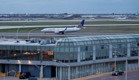 FILE PHOTO - A United Airline aircraft lands at O'Hare International Airport in Chicago