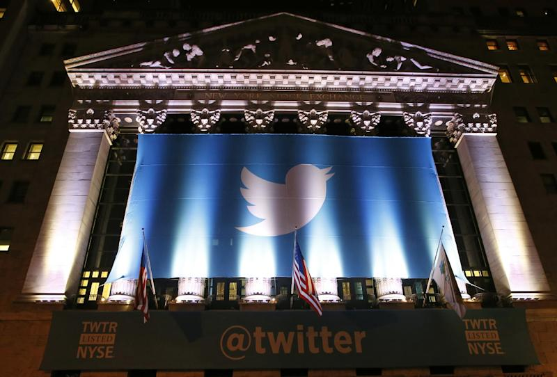 A banner adorns the facade of the New York Stock Exchange in advance of Twitter's initial public offering Thursday, Nov. 7, 2013, in New York. Twitter shares, valued at $26 per share, are set to begin trading on the stock exchange Thursday. The company is valued at $18.1 billion. (AP Photo/Kathy Willens)