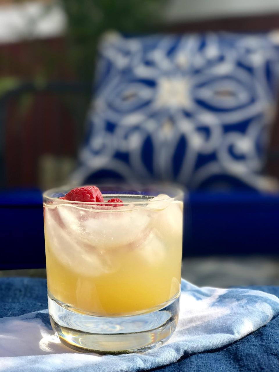 """<p>Peaches, Prosecco, and raspberries? It's like you're bottling Summer into a glass! You can thank Julie Hartigan, founder of <a href=""""http://cookingwjulie.com/"""" class=""""link rapid-noclick-resp"""" rel=""""nofollow noopener"""" target=""""_blank"""" data-ylk=""""slk:Cooking w/Julie"""">Cooking w/Julie</a>, for this 103-calorie cocktail. We recommend making enough of this punch to serve your whole crew!</p> <p><strong>Ingredients: </strong></p> <ul> <li>1 bottle Prosecco </li> <li>1 cup peach or mango juice </li> <li>1 cup raspberry seltzer </li> <li>6 dashes bitters </li> <li>Fresh or frozen raspberries for garnish </li> </ul> <p><strong>Directions:</strong> Combine all the ingredients together, and serve on the rocks. Garnish with raspberry.</p>"""
