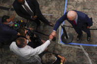 President Joe Biden fist bumps a doctor at the James Cancer Hospital and Solove Research Institute at The Ohio State University, Tuesday, March 23, 2021, in Columbus, Ohio. (AP Photo/Evan Vucci)