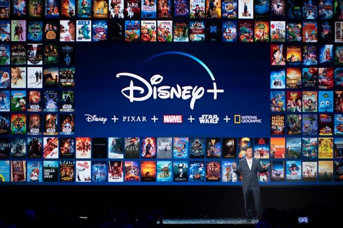 Disney executive showing off Disney+ on a stage