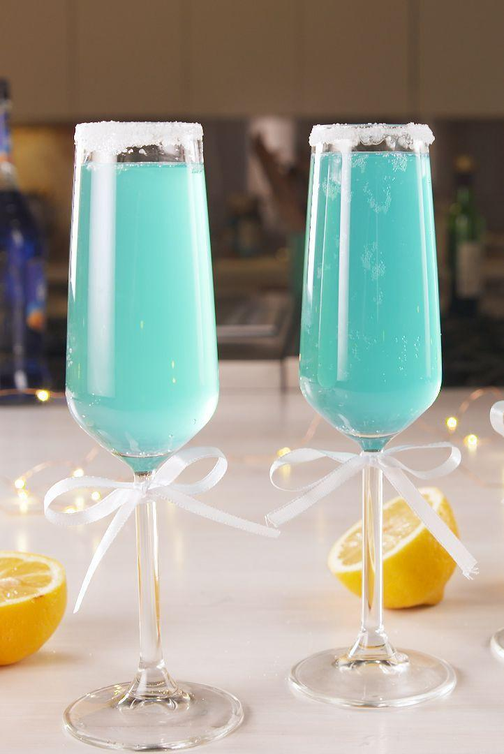 "<p>The ribbons are optional, but they're also super adorable. <br></p><p>Get the recipe from<a href=""https://www.delish.com/cooking/a20648910/tiffany-mimosas-recipe/"" rel=""nofollow noopener"" target=""_blank"" data-ylk=""slk:Delish"" class=""link rapid-noclick-resp""> Delish</a>.</p>"