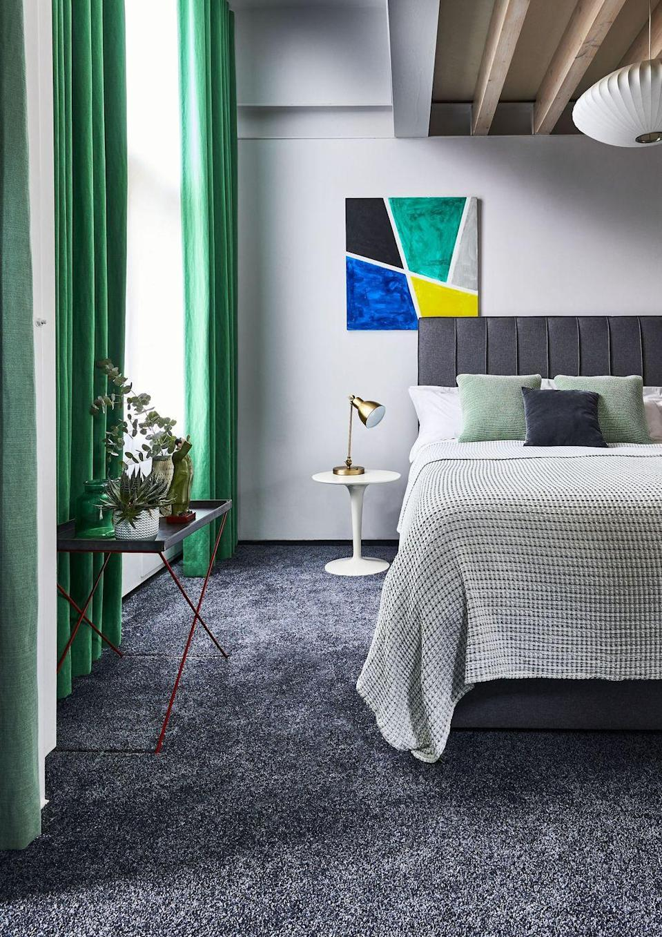 """<p>Introduce grey into your bedroom with carpet. It's a great base for so many colour schemes, either bold or subtle. This colour carpet is durable as it won't show the dirt and it has a textured look that adds another dimension – it's soft underfoot and adds a cosy feel to the room.<br></p><p>'Grey has consistently been one of the most popular home decorating shades over the last decade, and it shows no sign of slowing down any time soon,' says Jemma Dayman, Carpets Buyer at <a href=""""https://www.carpetright.co.uk/"""" rel=""""nofollow noopener"""" target=""""_blank"""" data-ylk=""""slk:Carpetright"""" class=""""link rapid-noclick-resp"""">Carpetright</a>. 'Given that the bedroom is our sanctuary, a calm space where we retreat to for rest, recuperation and to recover, it's no surprise that this soothing neutral hue is our go-to colour choice.'</p><p>Top tip: Don't forget to invest in good quality underlay, as this will not only increase insulation but also reduce wear over time and create an even softer feel underfoot.</p><p>Pictured: <a href=""""https://www.carpetright.co.uk/carpets/super-sublime-saxony-carpet/"""" rel=""""nofollow noopener"""" target=""""_blank"""" data-ylk=""""slk:Super Sublime Saxony Carpet in Midnight Tonal, House Beautiful collection at Carpetright"""" class=""""link rapid-noclick-resp"""">Super Sublime Saxony Carpet in Midnight Tonal, House Beautiful collection at Carpetright</a></p>"""