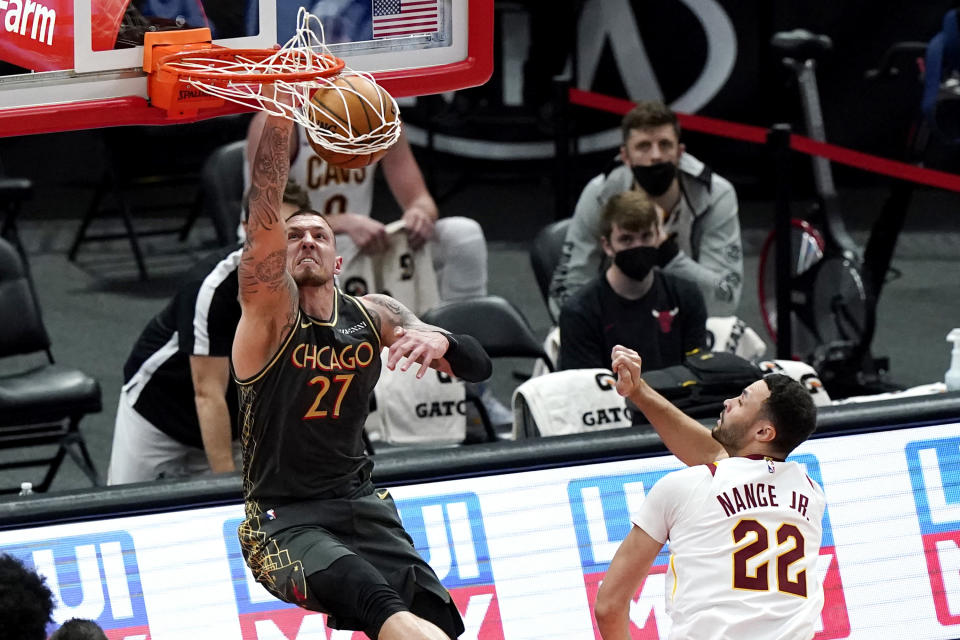 Chicago Bulls center Daniel Theis dunks as Cleveland Cavaliers forward Larry Nance Jr. watches during the second half of an NBA basketball game in Chicago, Saturday, April 17, 2021. (AP Photo/Nam Y. Huh)