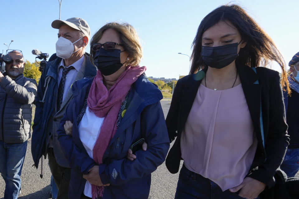 The family of slain Italian doctoral student Giulio Regeni, from left, father Claudio Regeni, mother Paola Deffendi, and Giulio's sister Irene, arrive at the Rebibbia prison in Rome, Thursday, Oct. 14, 2021, to attend the first hearing of the trial for the death of Italian doctoral student Giulio Regeni, who disappeared for several days in January 2016 before his body was found on a desert highway north of the Egyptian capital. Italian prosecutors have formally put four high-ranking members of Egypt's security forces under investigation for their alleged roles in the slaying. (AP Photo/Andrew Medichini)
