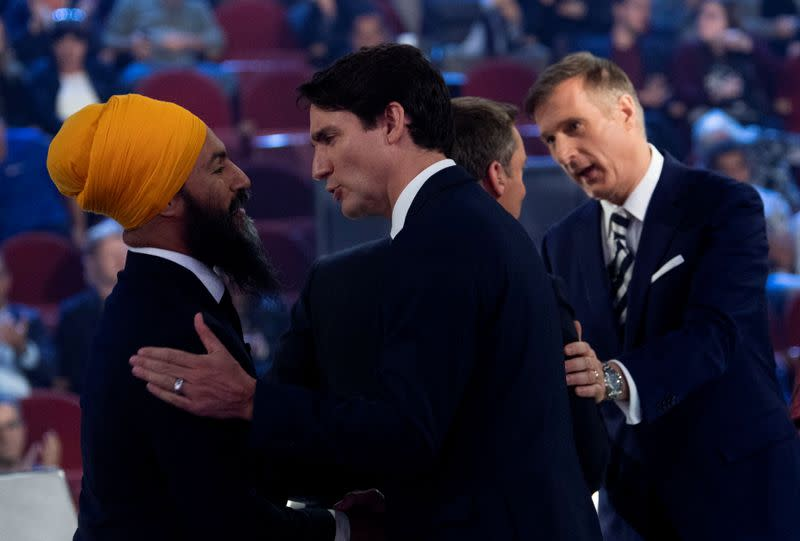 FILE PHOTO: Canada's Trudeau and Singh at 2019 Federal leaders French language debate in Gatineau
