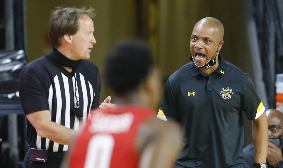 Wichita State interim coach Isaac Brown reacts to referee John Higgins after a call during the first half the team's NCAA college game against Houston on Thursday, Feb. 18, 2021 in Wichita, Kan. (Travis Heying/The Wichita Eagle via AP)
