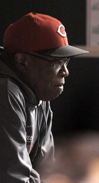 Cincinnati Reds manager Dusty Baker sits in the dugout during the second inning of a baseball game between the Reds and the Chicago Cubs in Chicago, Tuesday, Sept. 18, 2012. The game is Baker's 3,000th as a manager in the majors. (AP Photo/Paul Beaty)