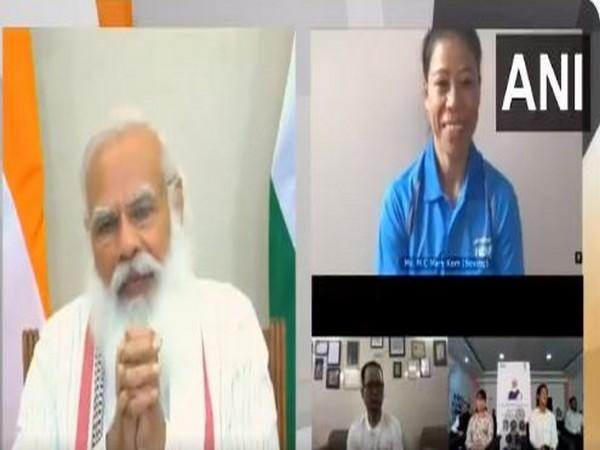 PM Modi interacts with Mary Kom.