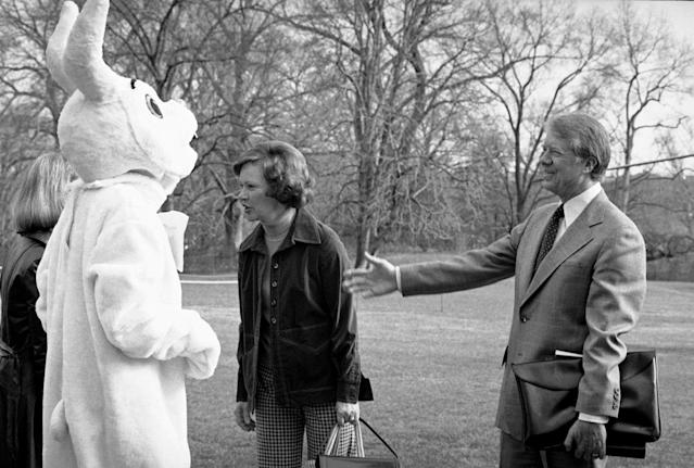 <p>President Jimmy Carter greets the Easter Bunny prior to his departure for a weekend at Camp David in Washington March 22, 1978. Inside the rabbit suit is Louise Dolan, who wore the suit to the departure as a gag. First lady Rosalynn Carter is speaking to Suzy Kerr who works with Dolan in the White House. (Photo: Jeff Taylor/AP) </p>