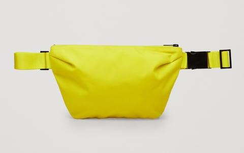 Luke's orange Flagstuff cross-body bag is now sold out at Goodhood.com. Similar alternatives, like this bag, £39, from Cos, are available.