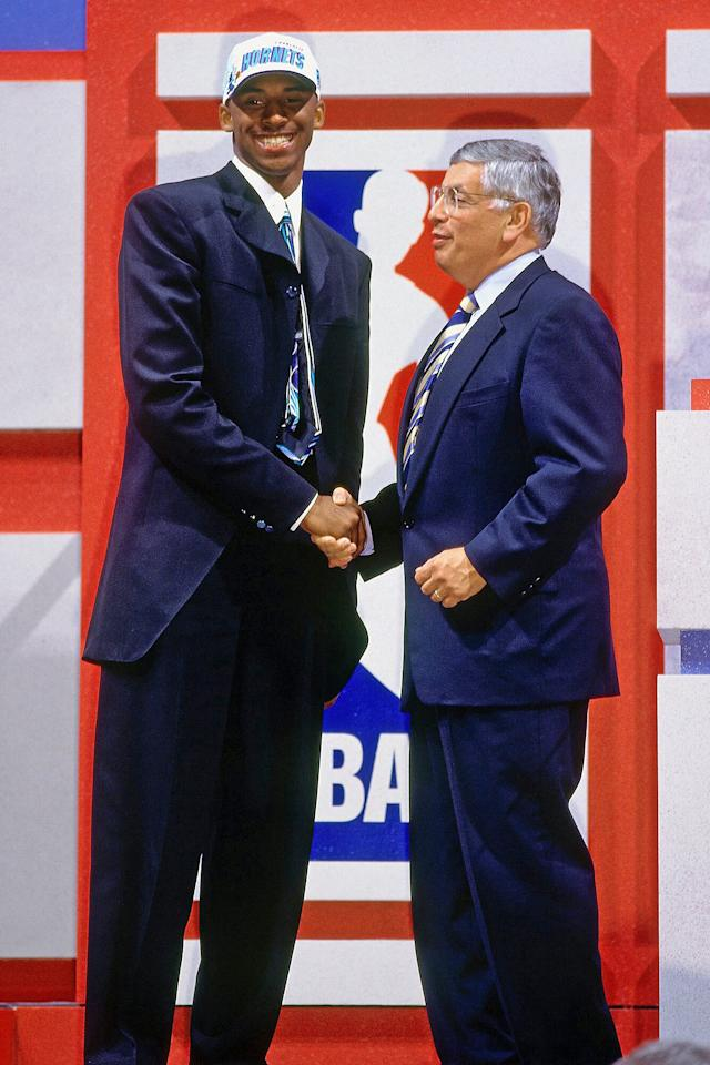 "Bryant shakes hands with then-NBA Commissioner David Stern (<a href=""https://people.com/sports/former-nba-commissioner-david-stern-dead-at-77/"">who died on Jan. 1, 2020</a>) after being selected in the first round of the 1996 NBA Draft on June 26, 1996, at Madison Square Garden in N.Y.C."