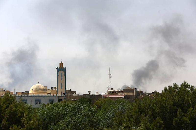 Black smoke rises in the area of Tripoli's international airport on August 20, 2014